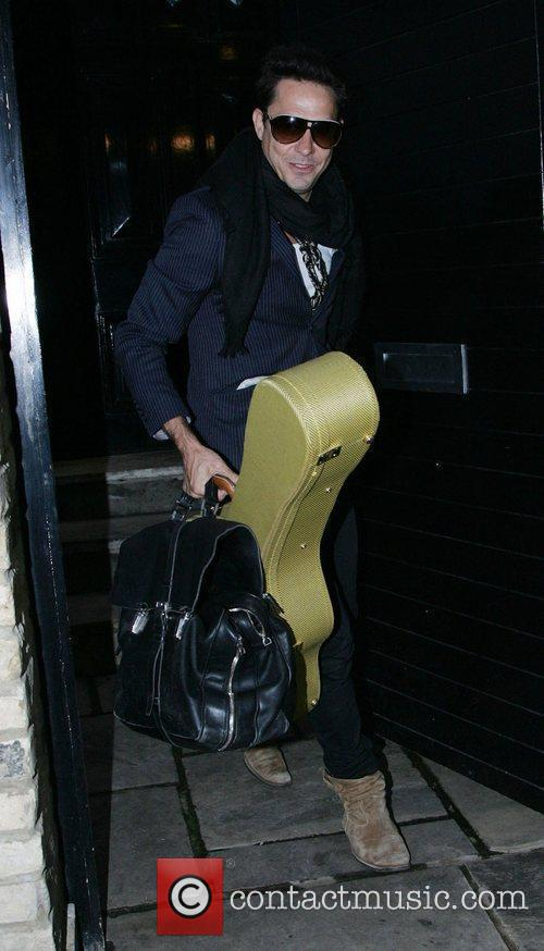 Jamie Hince  leaving home carrying his Guitar...