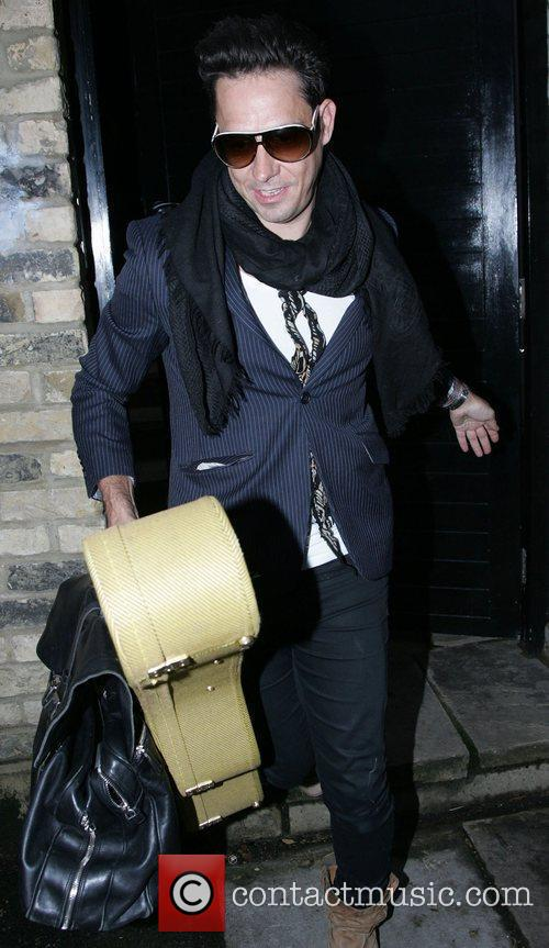 Leaving home carrying his Guitar case.