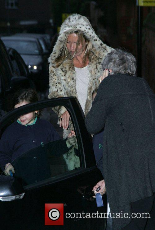 Kate Moss picks up her daughter Lila Grace...