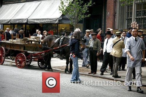 A horse and extras on the set of...
