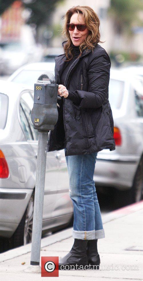 Katey Sagal pays a parking meter in West...