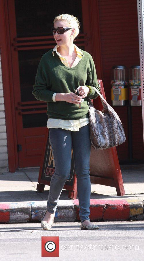 Katherine Heigl in a green loose jumper and...