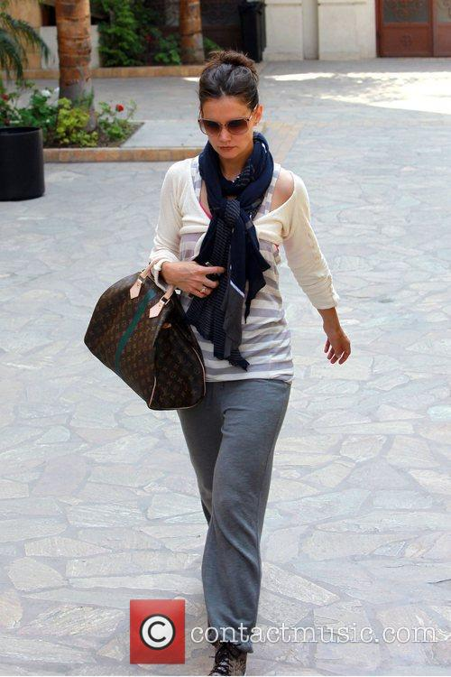 Katie Holmes  returns to her car after...