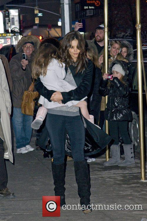 Katie Holmes carries her daughter, Suri Cruise, whilst...