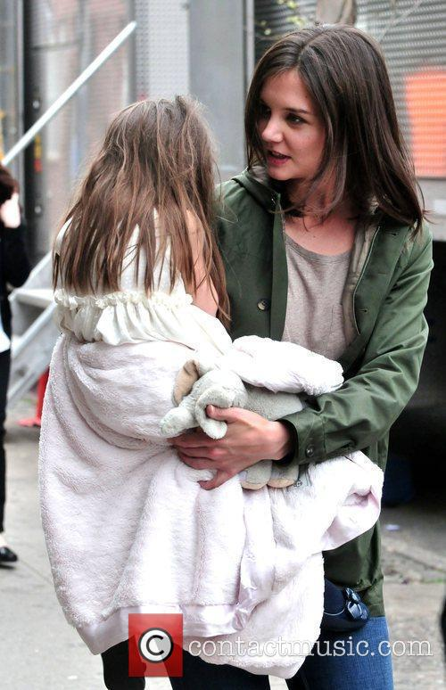 Katie Holmes and her daughter Suri Cruise on...