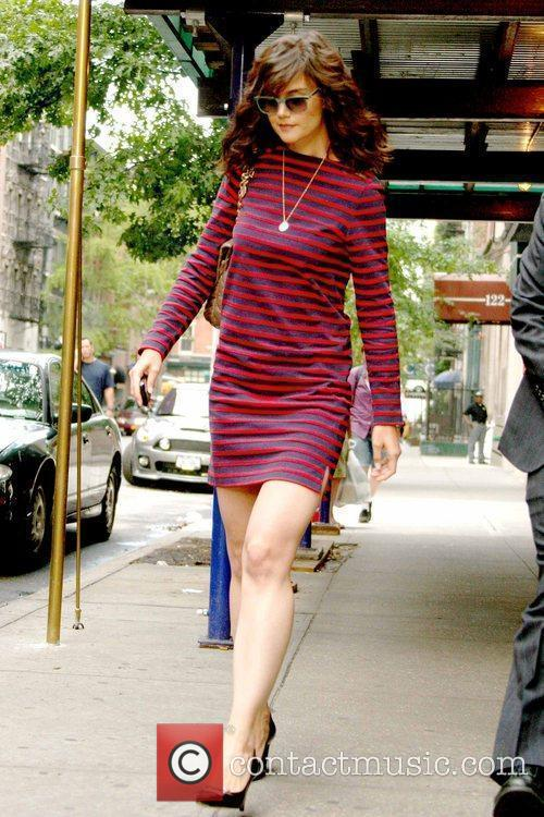 Leaving her Manhattan apartment wearing a striped dress