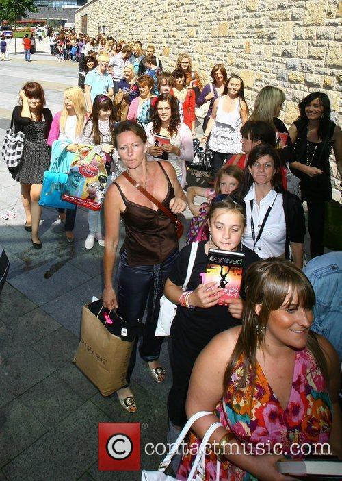 Fans queuing outside Katie Price promoting and signing...