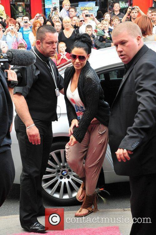 Katie Price  arrives at a signing for...
