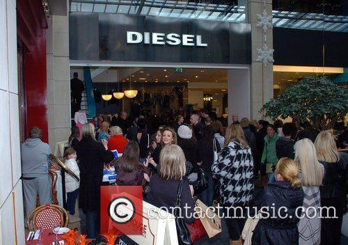 Fans Katie Price shops at the Diesel store...