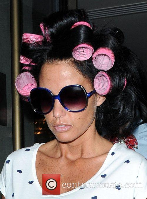 Leaving the Soho hotel with her hair rolled...
