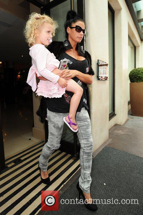 Katie Price and her daughter Princess Tiaamii leaving...