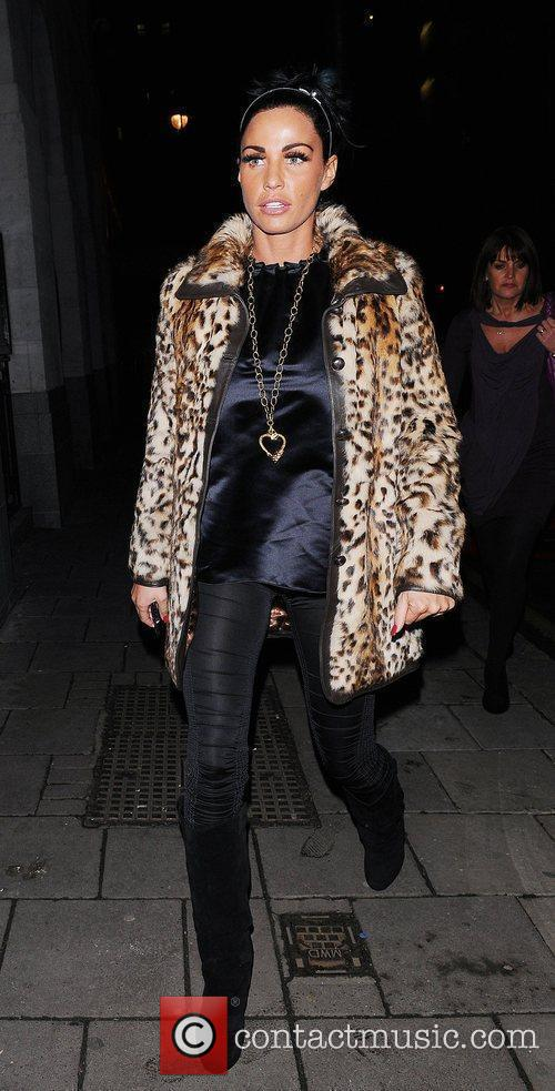 Katie Price, aka Jordan and wearing an animal print coat on her night out 10
