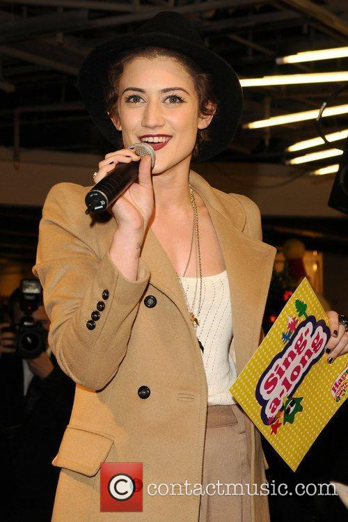 Performs a Christmas sing-a-long held at Selfridges department...