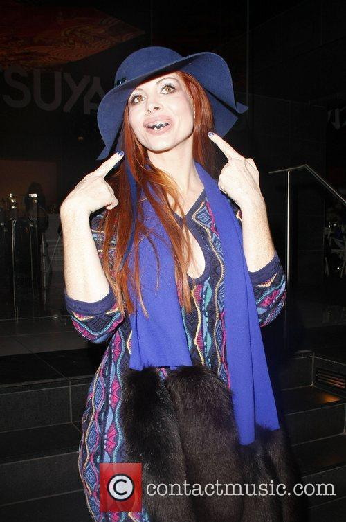 Phoebe Price wears a set of novelty fake...