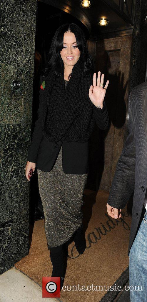 Katy Perry waves to photographers as she leaves...