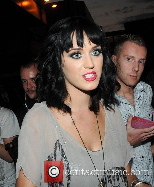 Katy Perry autographs t-shirts and poses for photographs...