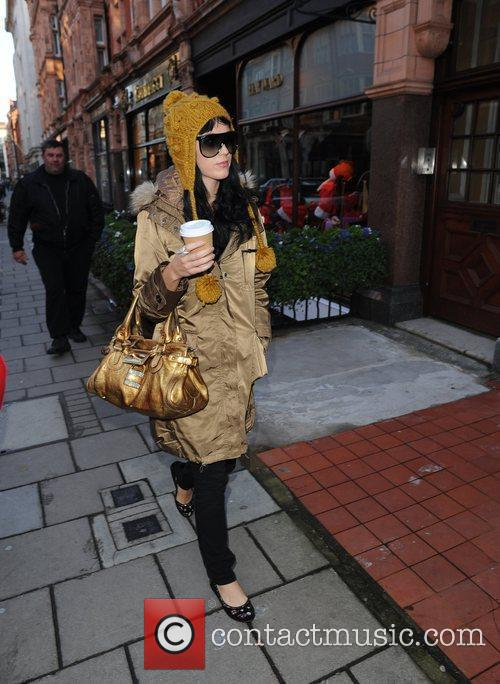 Katy Perry carrying a hot drink while shopping...