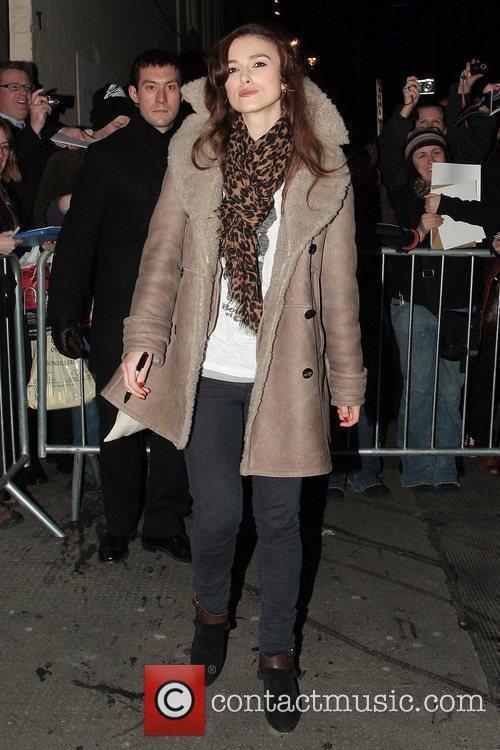 Keira Knightley, wearing a leopard print scarf, leaving...
