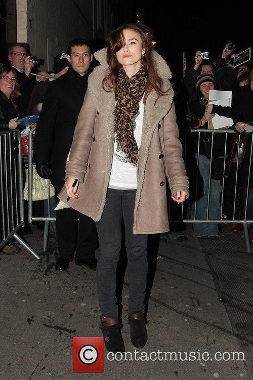 Keira Knightley, wearing a leopard print scarf, leaving...