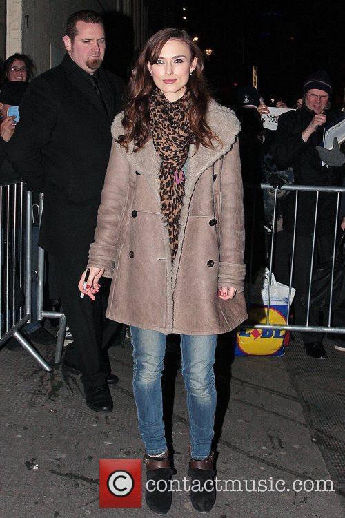 Keira Knightley, wearing her favorite leopard print scarf...
