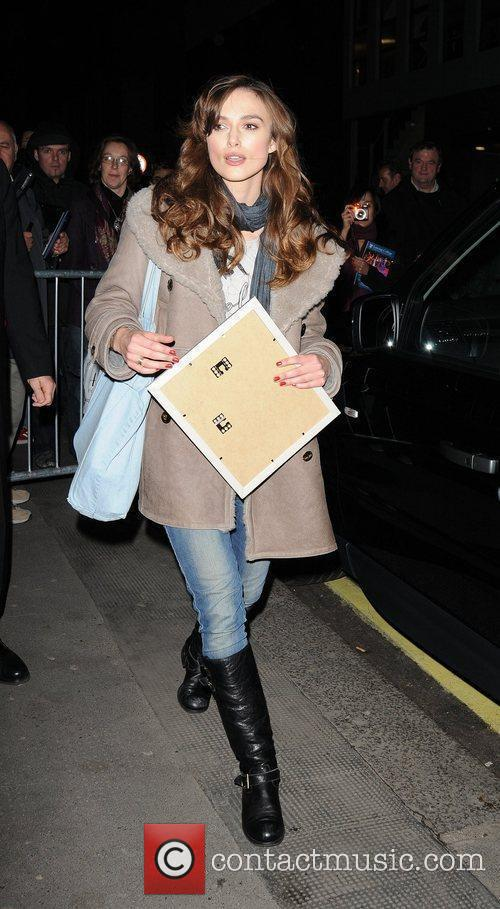 Keira Knightley signs autographs for fans as she...
