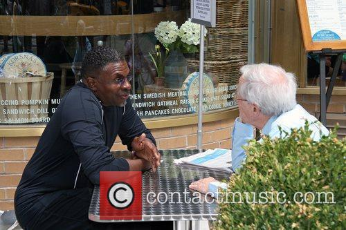 Keith David having a conversation with a friend...