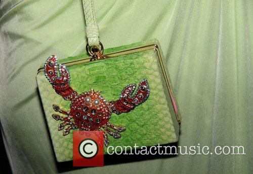 Kelis sporting a bag with a crab on...