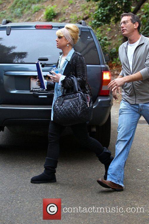 Kelly Osbourne arrives at a studio for her...