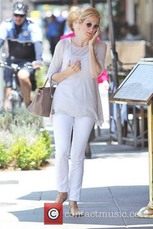 Kelly Rutherford talking on her cellphone as she...