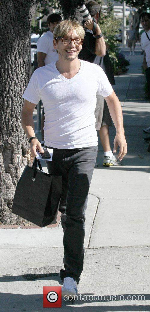 Ken Paves in a tight, white t-shirt, leaves...