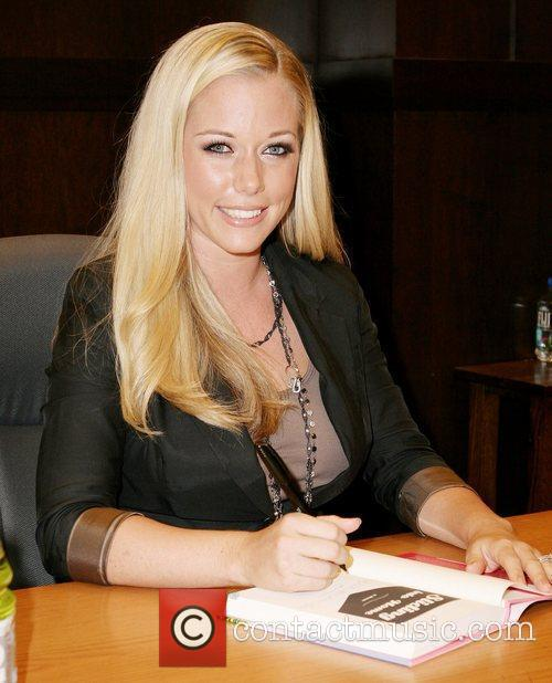 Kendra Wilkinson signs copies of her new book...