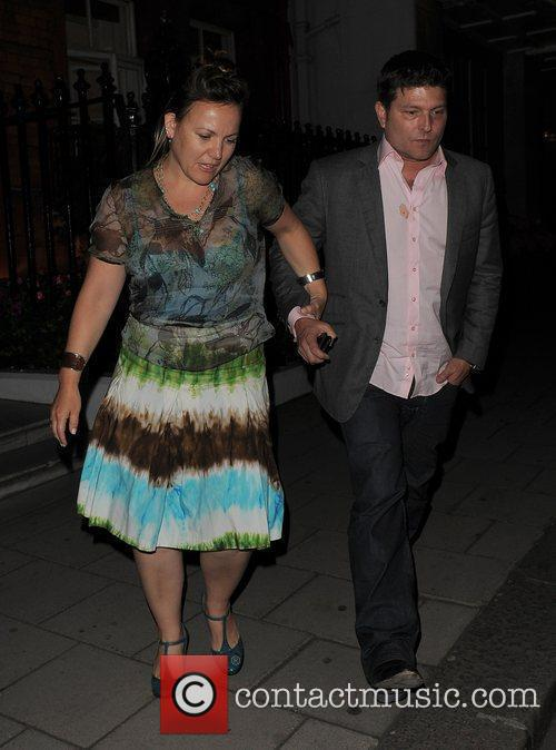 Kenny Goss leaving Claridges hotel with a female...