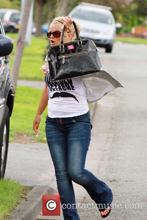 Kerry Katona arrives at a friend's house to...