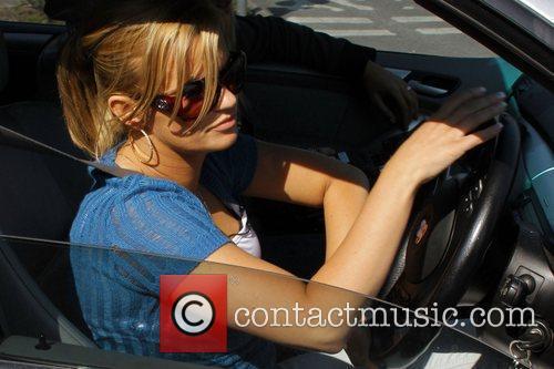 Kerry Katona driving her car after visiting her...