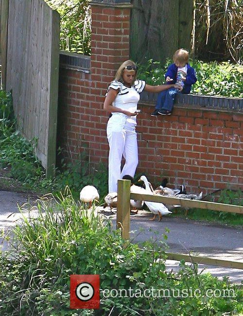 Kerry Katona and son Max Croft feeding the...