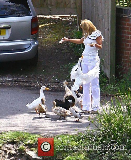 Kerry Katona feeding the ducks by her house...