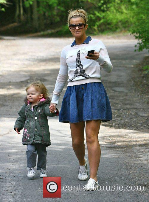 Outside her house with her daughter Heidi wearing...