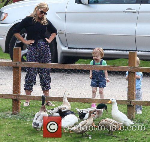 Kerry Katona feeding the ducks with her children...