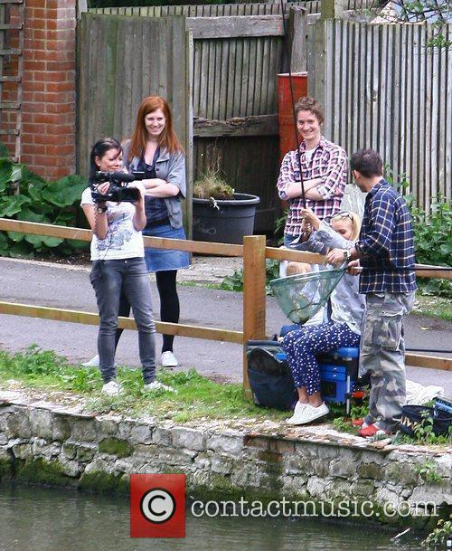 Kerry Katona doing a spot of fishing with...