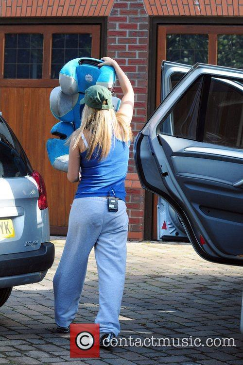 Kerry Katona leaves her house and takes out...