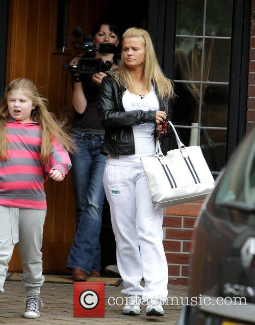 Kerry Katona leaves her house with her daughter...