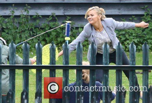 Kerry Katona and her children play Swingball outside...