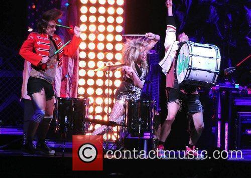 Performs at the American Airline Arena as support...