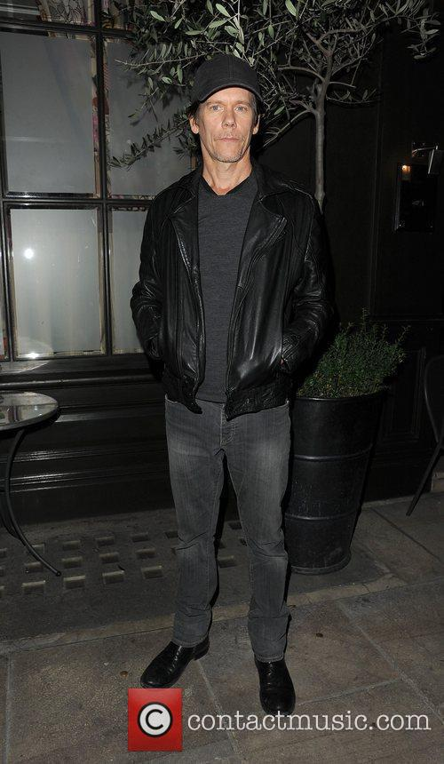 Kevin Bacon arriving back at his hotel, appearing...