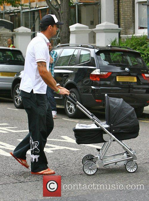 Kevin Pietersen walking to a cafe with his...