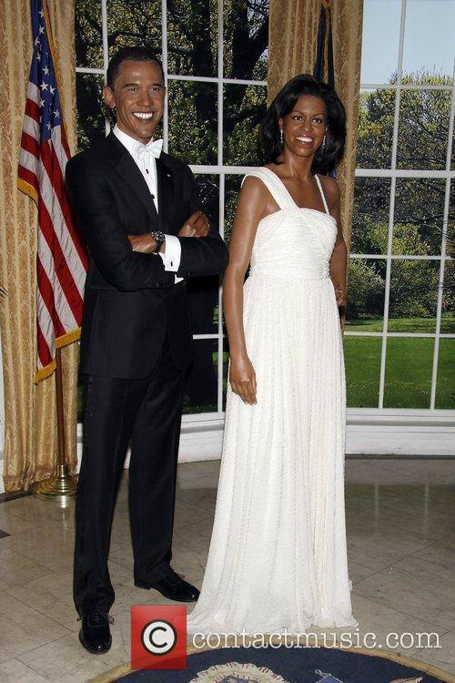 Barack and Michelle Obama wax figures on display...