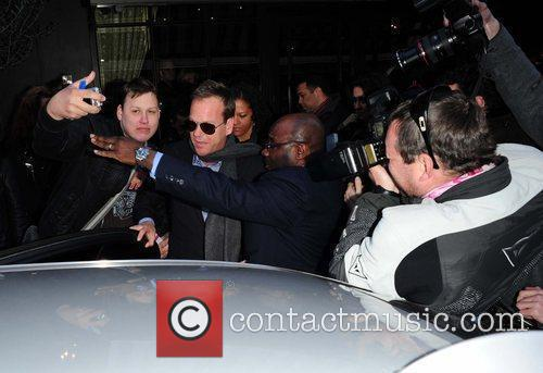 Kiefer Sutherland surrounded by the paparazzi as he...