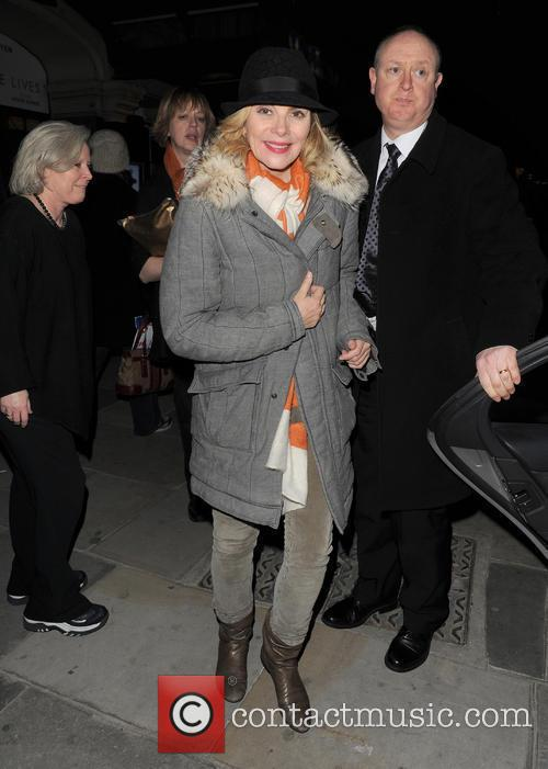 Kim Cattrall is all smiles as she leaves...