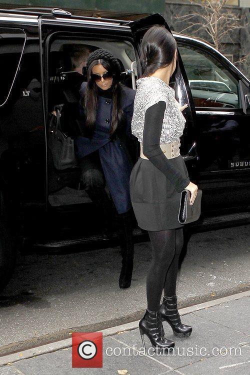 Kim Kardashian and Kourtney Kardashian 15