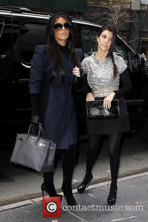 Kim Kardashian and Kourtney Kardashian 14